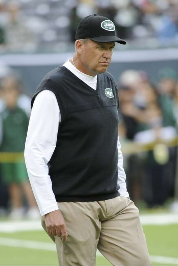 New York Jets head coach Rex Ryan walks on the field before an NFL football game against the Buffalo Bills Sunday, Sept. 22, 2013, in East Rutherford, N.J. (AP Photo/Bill Kostroun)