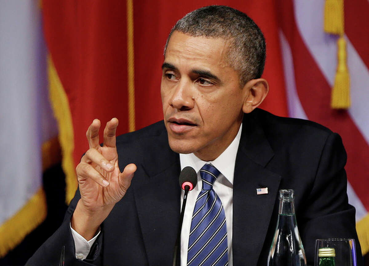 President Barack Obama gestures as he speaks during a roundtable event sponsored by the Civil Society, Monday, Sept. 23, 2013, in New York. (AP Photo/Frank Franklin II)