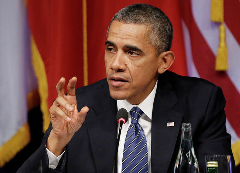 President Barack Obama gestures as he speaks during a roundtable event sponsored by the Civil Society, Monday, Sept. 23, 2013, in New York. (AP Photo/Frank Franklin II) / AP