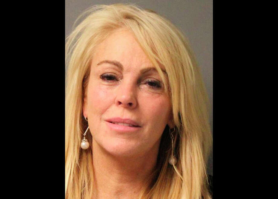 FILE - This file photo provided by the New York State Police in East Farmingdale, N.Y., shows Dina Lohan, mother of Lindsay Lohan, after she was arrested late Thursday, Sept. 12, 2013 on aggravated drunken driving charges. Lohan has a scheduled court appearance Tuesday, Sept. 24, 2013, to answer the charges. (AP Photo/New York State Police, File) / New York State Police