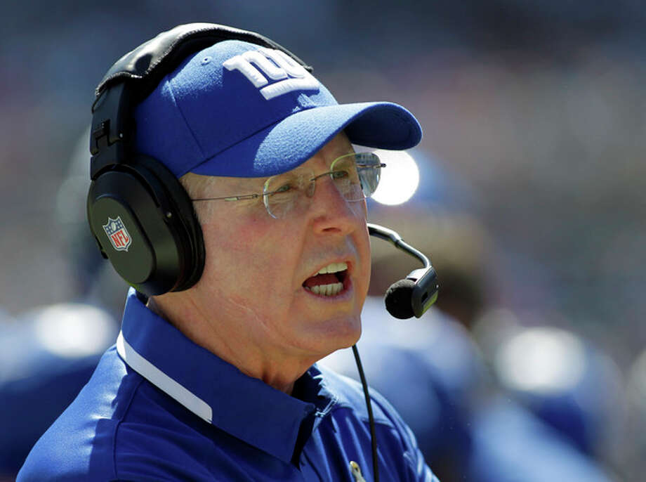 New York Giants head coach Tom Coughlin looks on during the first half of an NFL football game against the Carolina Panthers in Charlotte, N.C., Sunday, Sept. 22, 2013. (AP Photo/Bob Leverone) / FR170480 AP