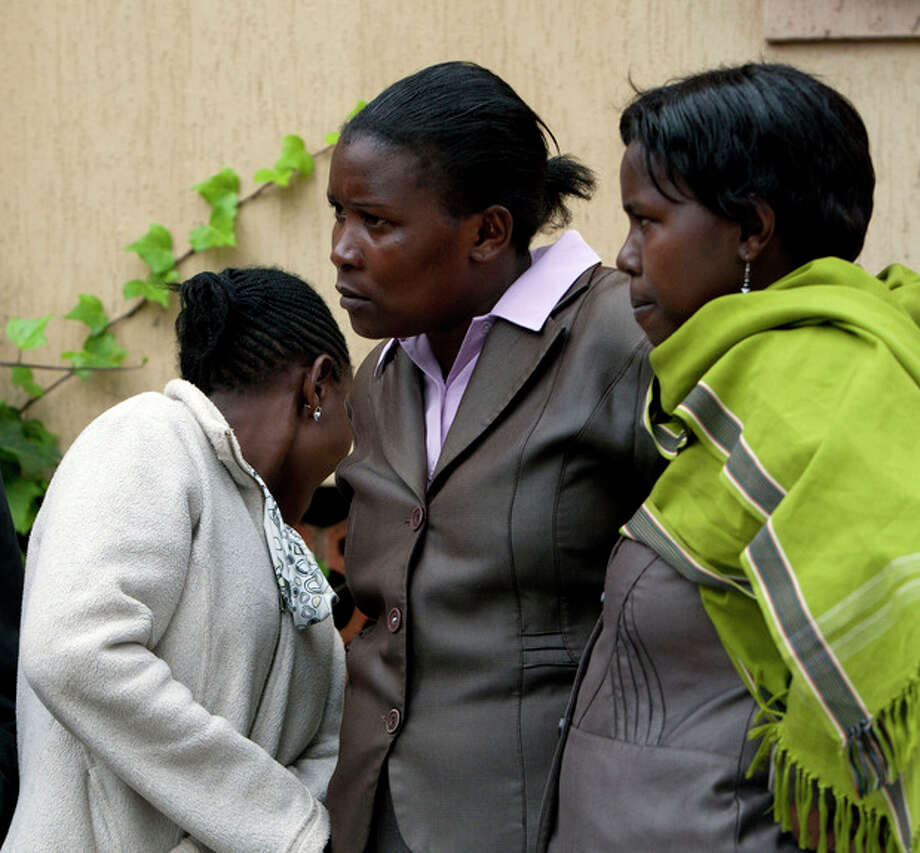 Relatives and friends of the people still reported missing in the Westgate attack, wait for information on loved-ones at Oshwal Centre near the Westgate Mall in Nairobi, Kenya Tuesday, Sept. 24, 2013. Kenyan security forces battled al-Qaida-linked terrorists in an upscale mall for a fourth day. Another explosion and more gunfire could be heard coming from the mall in the early hours of Tuesday morning. (AP Photo/Sayyid Azim) / AP