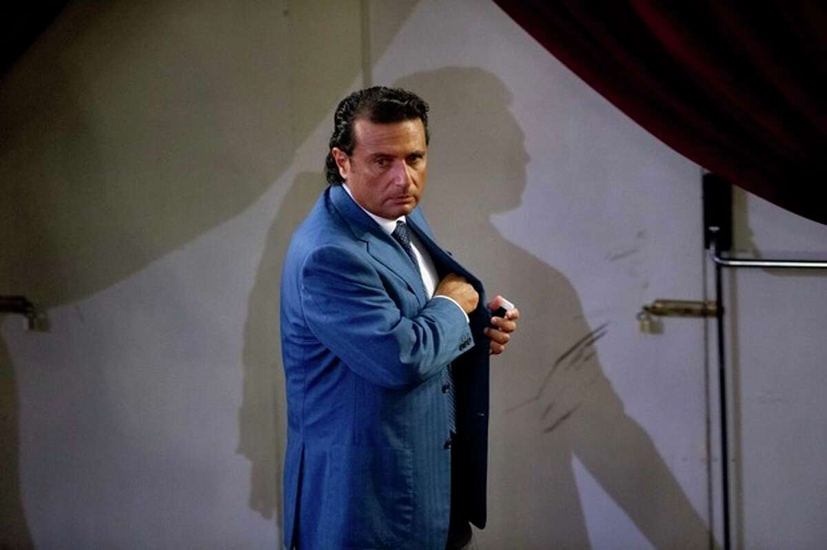 Captain Francesco Schettino leaves the court room of the converted Teatro Moderno theater on the second day of his trial, in Grosseto, Italy, Tuesday, Sept. 24, 2013. The captain of the wrecked Costa Concordia is charged with manslaughter, causing the shipwreck and abandoning ship before the luxury cruise liner's 4,200 passengers and crew could be evacuated on Jan. 13, 2012 when the ship collided with a reef off the Tuscan island of Giglio, killing 32 people. Schettino blames his helmsman for botching a last-minute corrective maneuver that he contends could have prevented the massive cruise ship's collision with the reef. (AP Photo/Andrew Medichini)