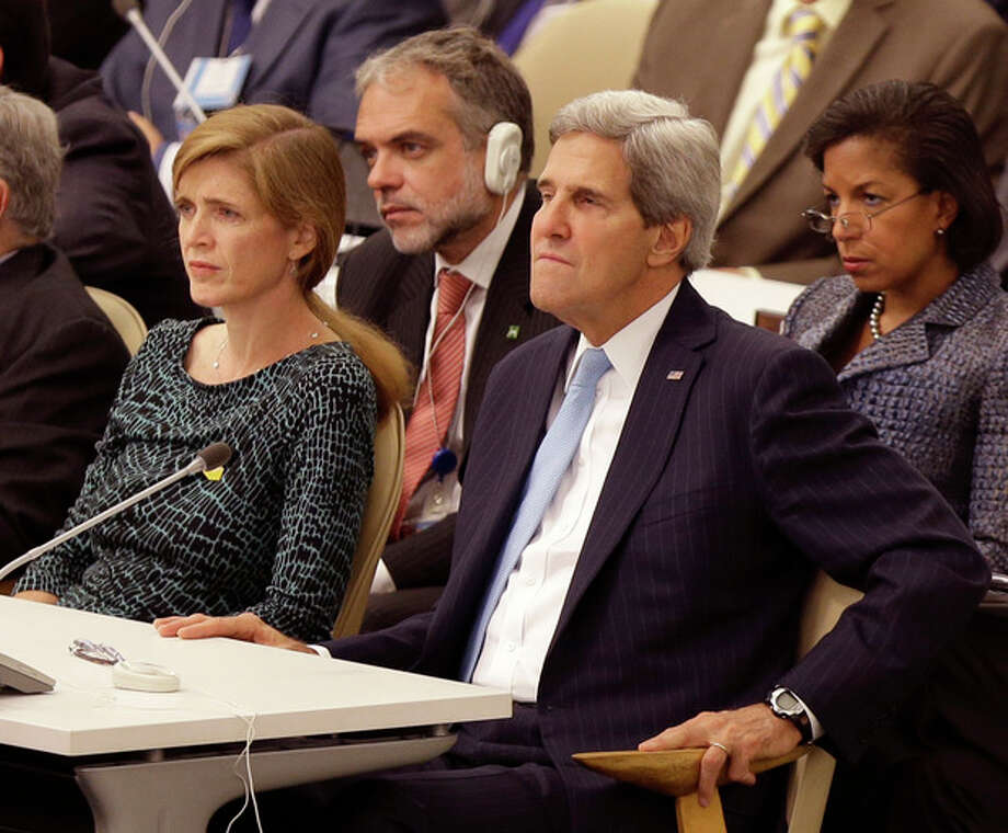 United States Ambassador to the United Nations Samantha Power, left, Secretary of State John Kerry, second from right, and National Advisor Susan Rice, right, listen while U.S. President Barack Obama speaks during the 68th session of the General Assembly at United Nations headquarters. (AP Photo/Seth Wenig) / AP