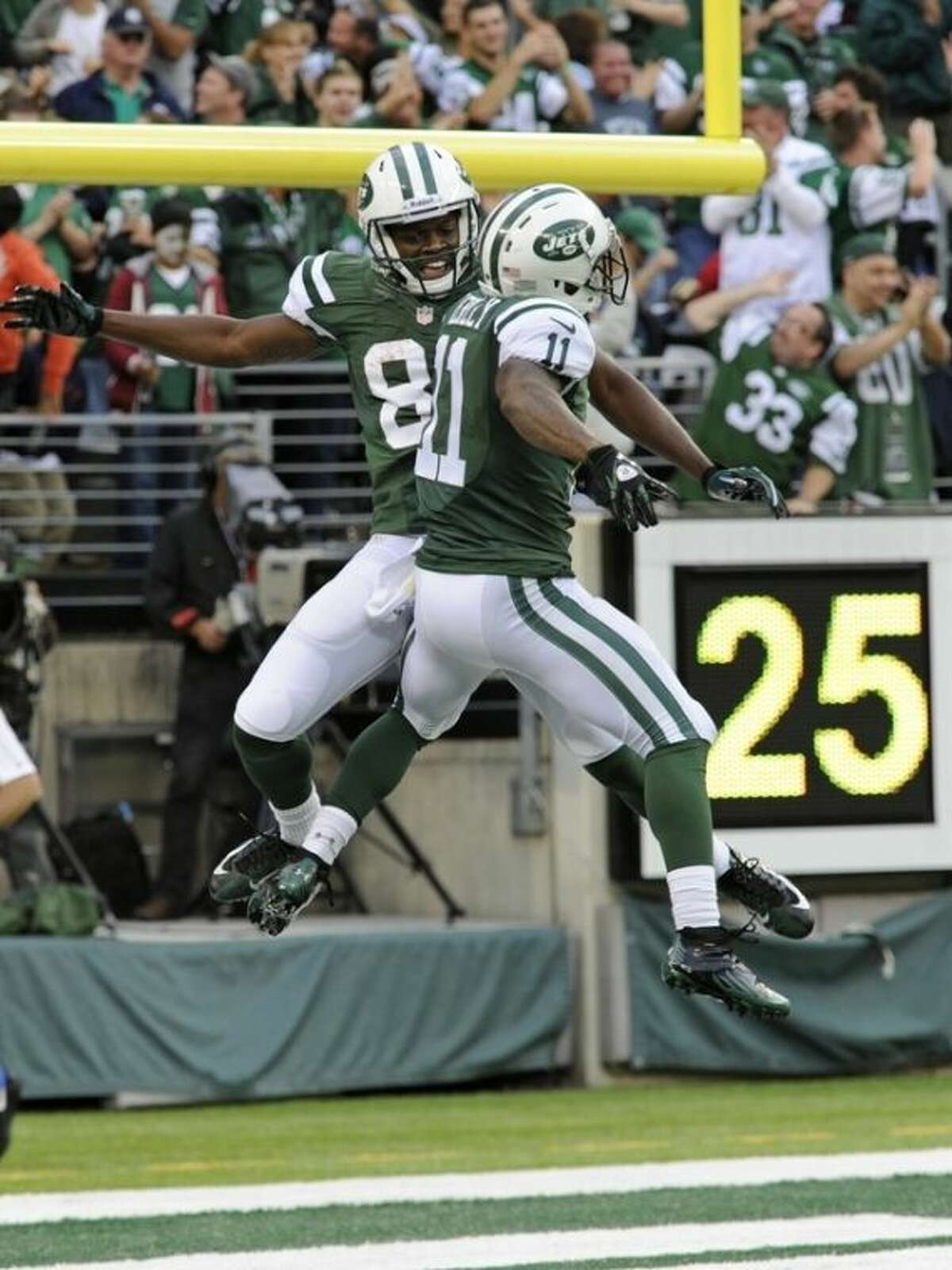 New York Jets wide receiver Stephen Hill, left, celebrates with teammate Jeremy Kerley after scoring a touchdown during the first half of an NFL football game against the Buffalo Bills Sunday, Sept. 22, 2013, in East Rutherford, N.J. (AP Photo/Bill Kostroun)