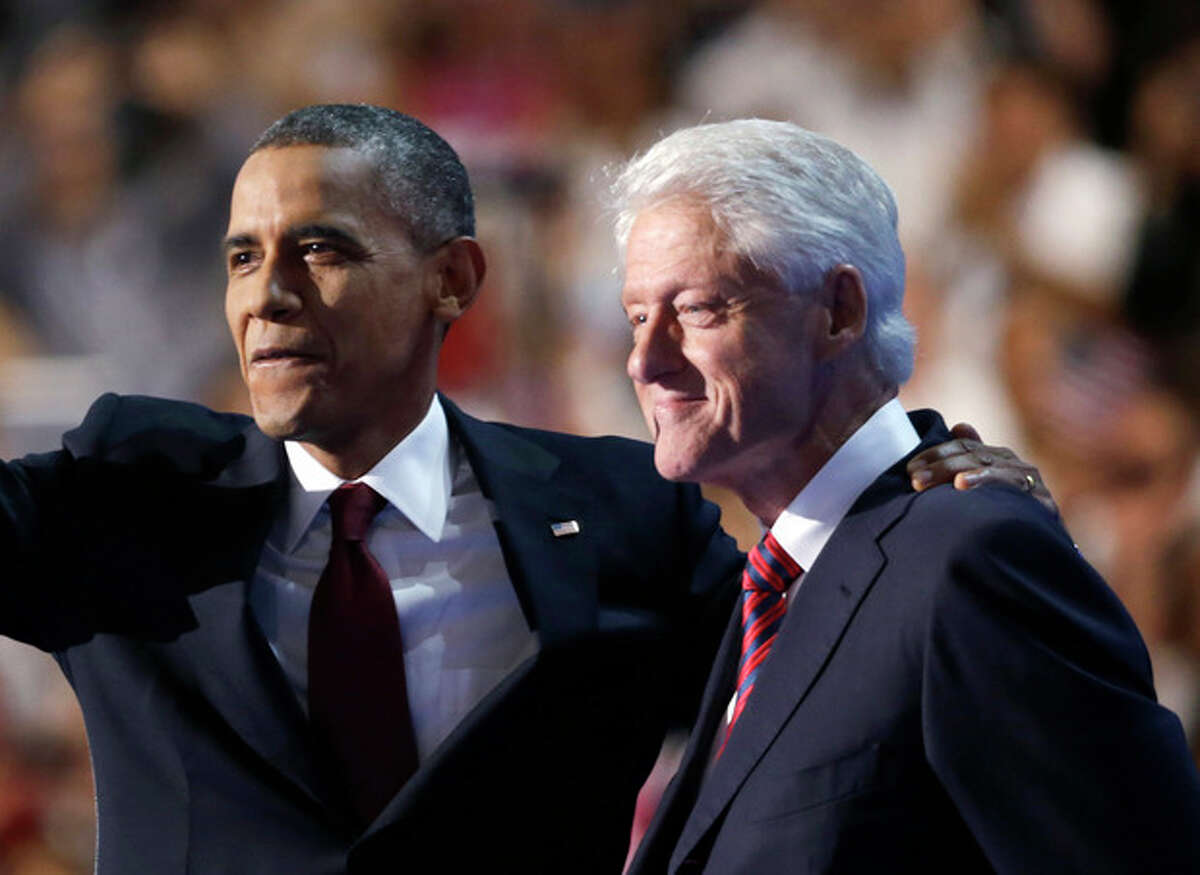 FILE - In this Sept. 5, 2012 file photo, President Barack Obama, accompanied by former President Bill Clinton are seen at the Democratic National Convention in Charlotte, N.C. Health care is reuniting President Barack Obama and former President Bill Clinton. The two are set to appear together Tuesday to discuss Obama's health care law at a session sponsored by the Clinton Global Initiative, the former president's foundation. (AP Photo/David Goldman, File)