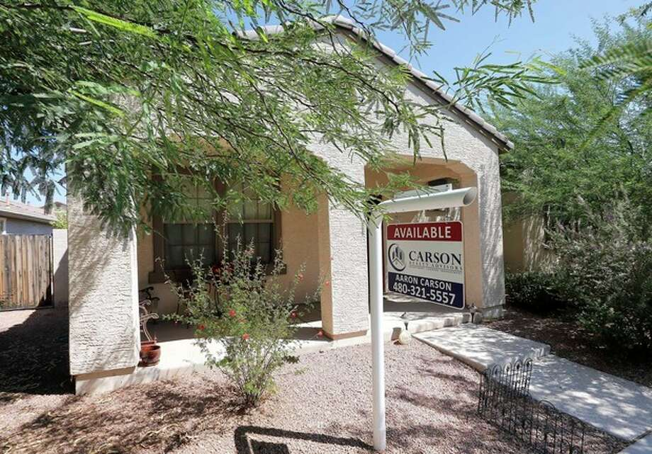 FILE - In this Tuesday, July 30, 2013, file photo, a realty sign hangs in front of a home for sale in Gilbert, Ariz .Standard & Poor's Case-Shiller reports on home prices in July on Tuesday, Sept. 24, 2013. (AP Photo/Matt York, File) / AP