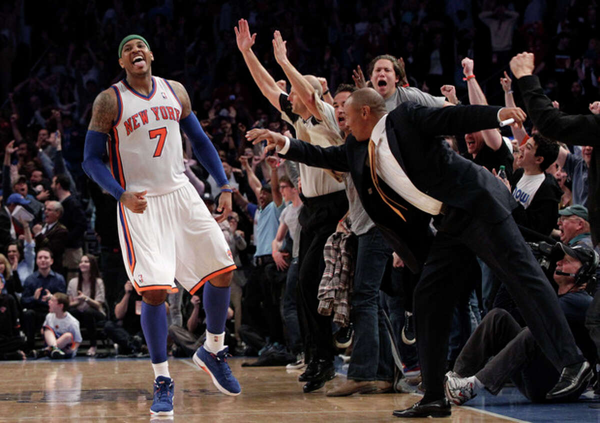 FILE- In this April 8, 2012, file photo, New York Knicks' Carmelo Anthony and fans react after Anthony scored a 3-point basket in the closing seconds of overtime in an NBA basketball game against the Chicago Bulls at Madison Square Garden in New York. Two people with knowledge of the plans say the 2015 NBA All-Star weekend will be split between two New York arenas, with Madison Square Garden to host the game. Barclays Center in Brooklyn will host the Saturday skills events, the people confirmed to The Associated Press on condition of anonymity Tuesday, Sept. 24, 2013, because the plans were to be announced at a press conference Wednesday. (AP Photo/Mary Altaffer, File)