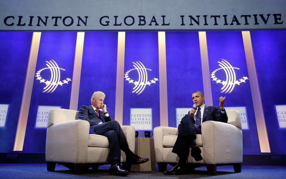President Barack Obama, right, with former President Bill Clinton, left, speaks at the Clinton Global Initiative in New York, Tuesday, Sept. 24, 2013. (AP Photo/Pablo Martinez Monsivais) / AP