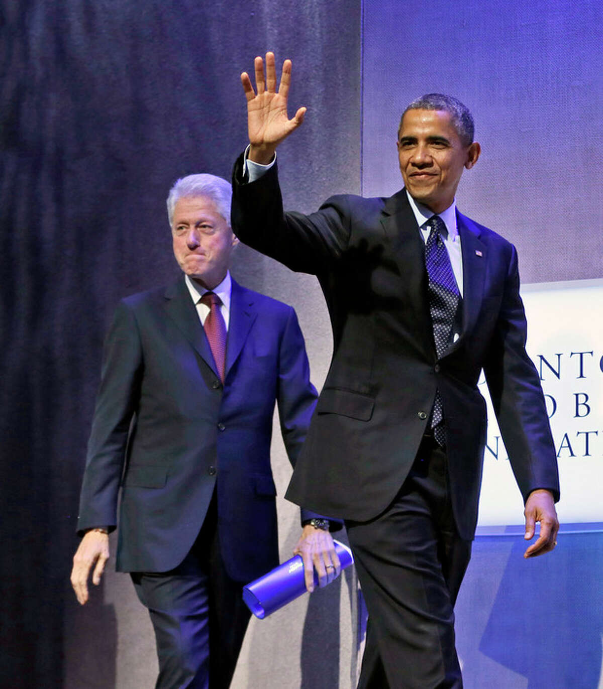 President Barack Obama, right, walks on stage with former President Bill Clinton, left, before speaking at the Clinton Global Initiative in New York, Tuesday, Sept. 24, 2013. (AP Photo/Pablo Martinez Monsivais)
