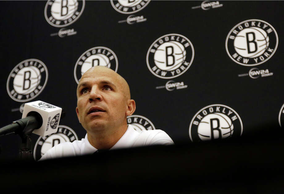 New Jersey Nets head coach Jason Kidd listens to a question during a media availability at the team's NBA basketball training facility, Tuesday, Sept. 24, 2013, in East Rutherford, N.J. (AP Photo/Julio Cortez) / AP