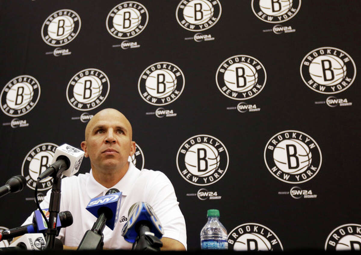 New Jersey Nets head coach Jason Kidd listens to a question during a media availability at the team's NBA basketball training facility, Tuesday, Sept. 24, 2013, in East Rutherford, N.J. (AP Photo/Julio Cortez)
