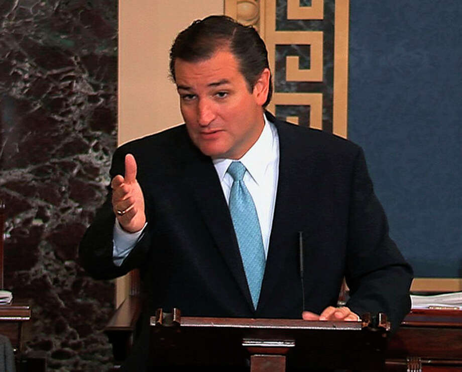 This image from Senate video show Sen. Ted Cruz, R-Texas, speaking on the Senate floor at the U.S. Capitol in Washington, Tuesday, Sept. 24, 2013. Cruz says he will speak until he's no longer able to stand in opposition to President Barack Obama's health care law. Cruz began a lengthy speech urging his colleagues to oppose moving ahead on a bill he supports. The measure would prevent a government shutdown and defund Obamacare. (AP Photo/Senate TV) / Senate TV