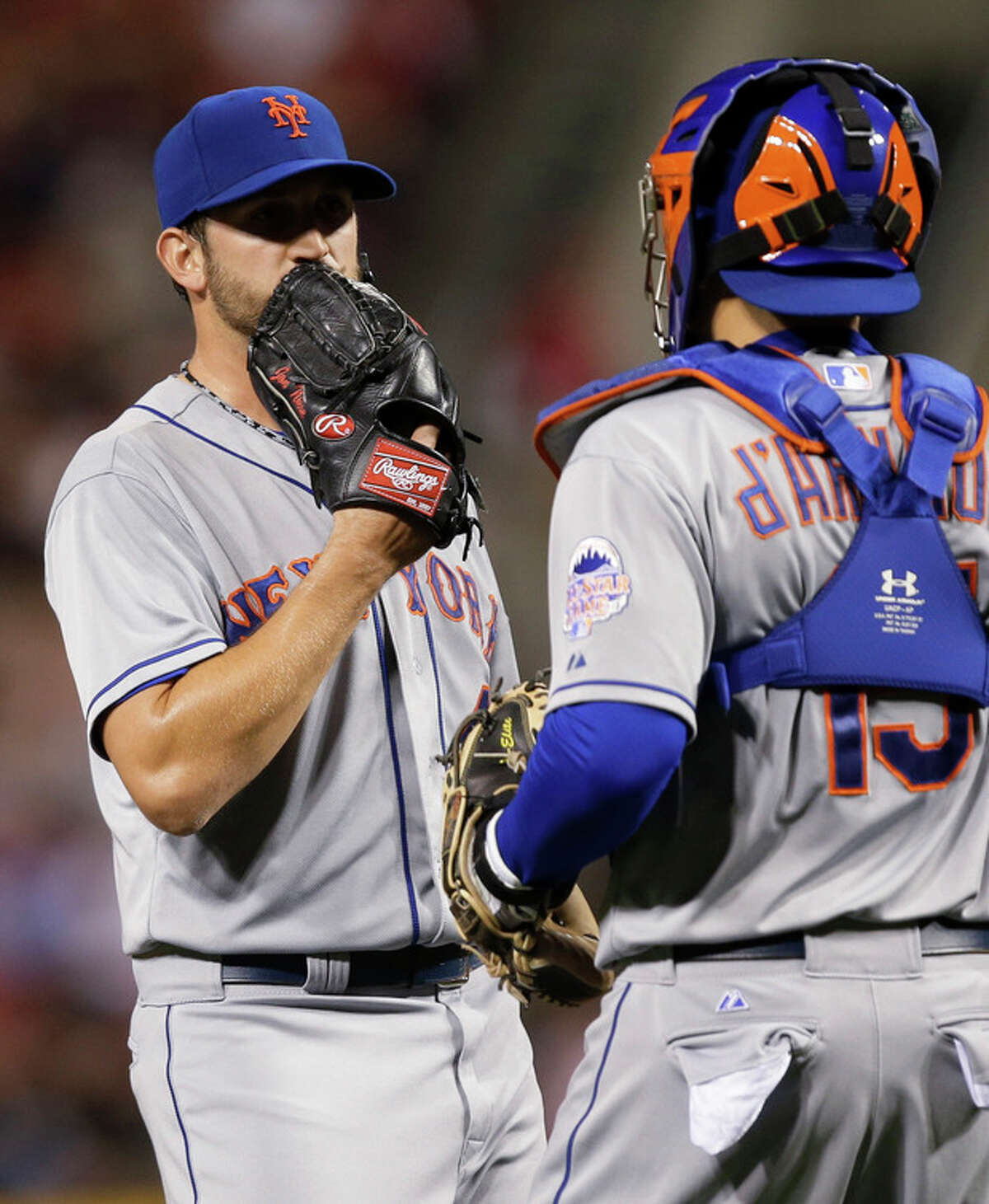 New York Mets starting pitcher Jonathon Niese talks with catcher Travis d'Arnaud in the fourth inning of a baseball game against the Cincinnati Reds, Tuesday, Sept. 24, 2013, in Cincinnati. (AP Photo/Al Behrman)