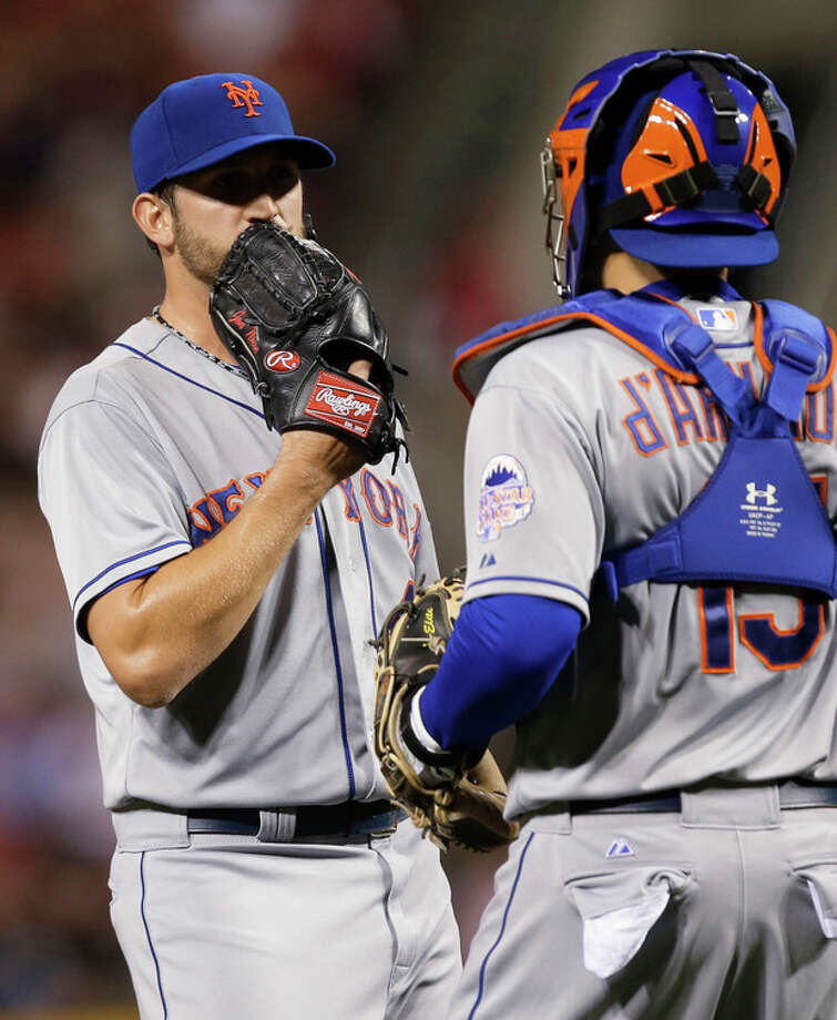 New York Mets starting pitcher Jonathon Niese talks with catcher Travis d'Arnaud in the fourth inning of a baseball game against the Cincinnati Reds, Tuesday, Sept. 24, 2013, in Cincinnati. (AP Photo/Al Behrman) / AP