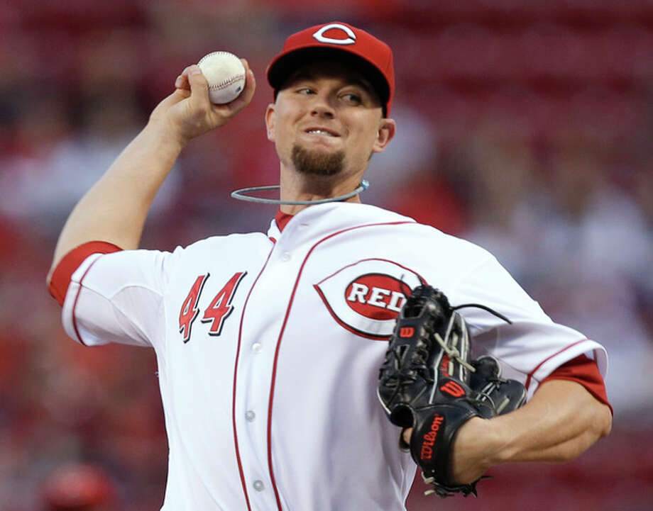 Cincinnati Reds starting pitcher Mike Leake throws against the New York Mets in the first inning of a baseball game, Tuesday, Sept. 24, 2013, in Cincinnati. (AP Photo/Al Behrman) / AP