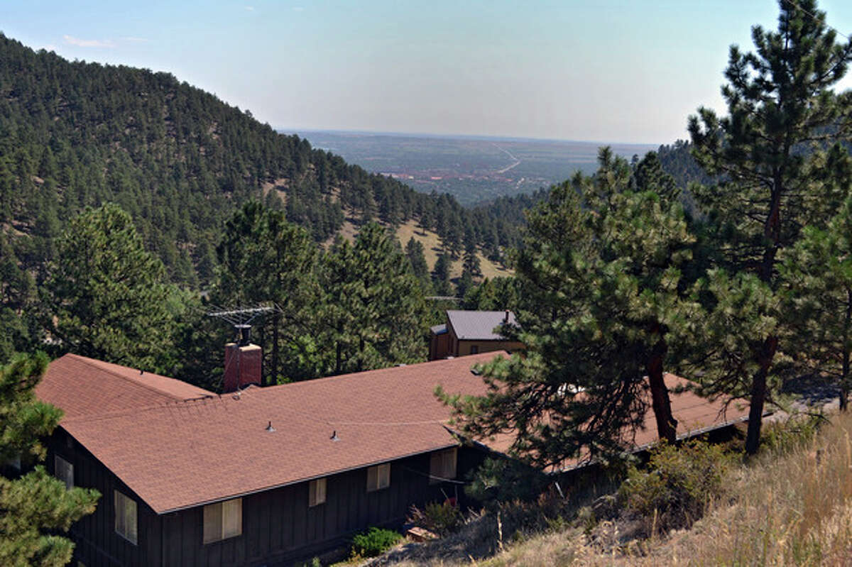 This Sept. 6, 2013 photo shows a home built in the mountains west of Boulder, Colo. The National Institute of Standards and Technology is developing the Wildland Urban Interface Hazard Scale to get a measurement of the intensity of a wildfire moving through areas such as this. (AP Photo/P. Solomon Banda)