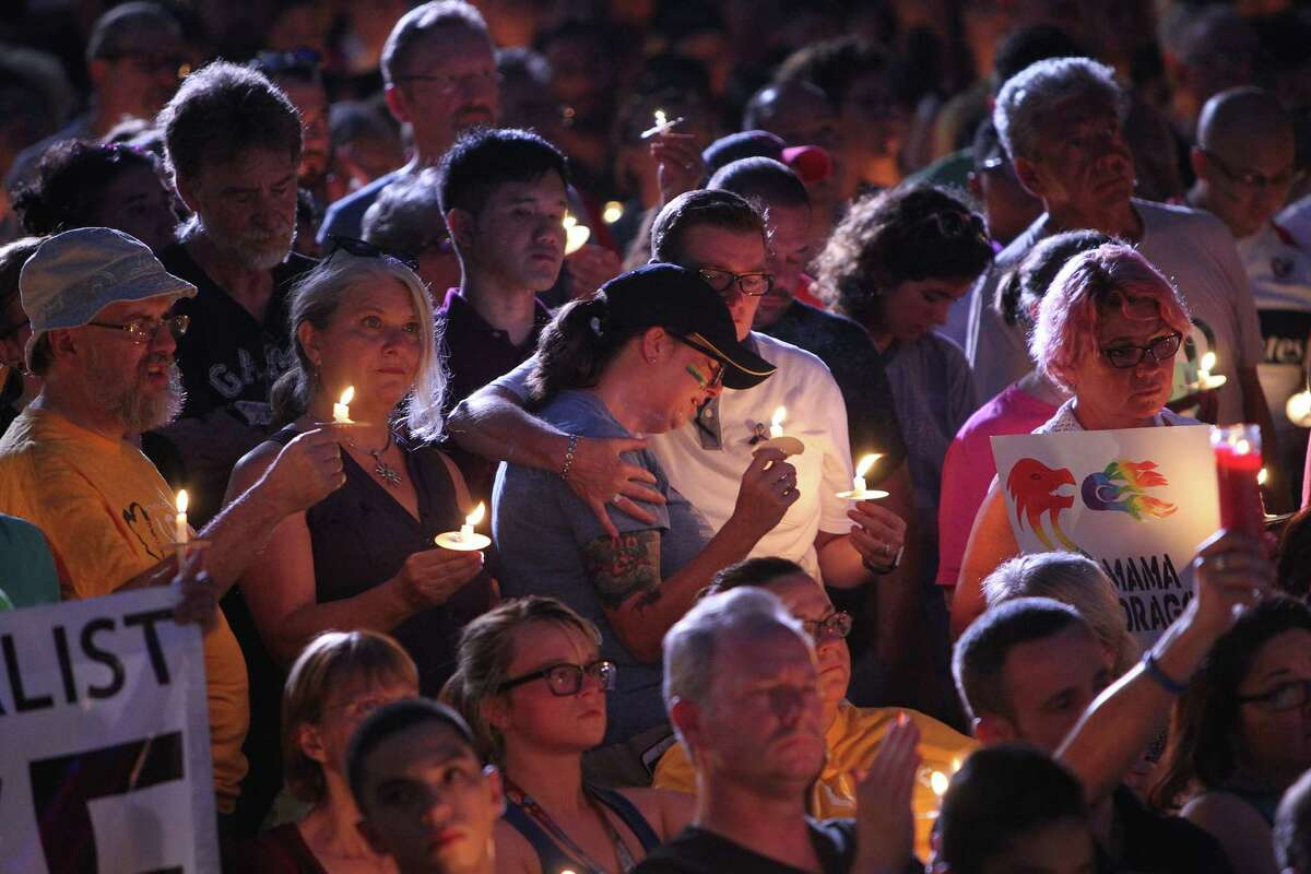 People hold candles at the vigil at City Hall on Wednesday.