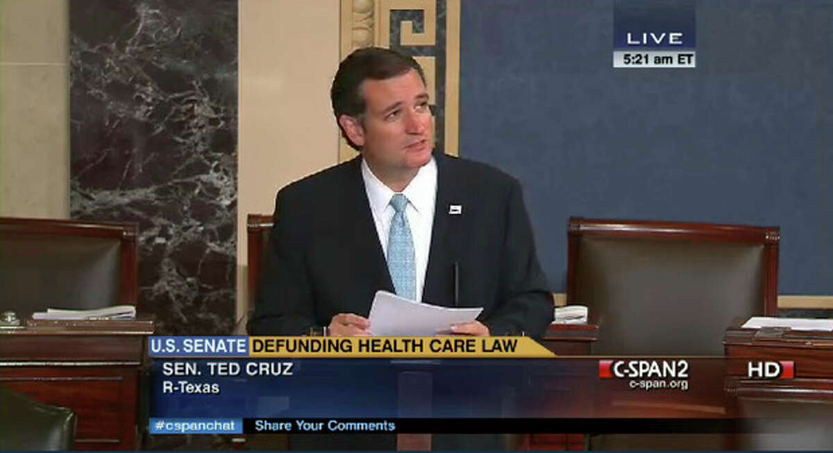 In an image made from the C-Span broadcast Senator Ted Cruz continues to speak on the floor of the U.S. Senate at 5:21 a.m. EDT Wednesday Sept. 25, 2013. Since Tuesday afternoon, Cruz _ with occasional remarks by Sen. Mike Lee, R-Utah, and other GOP conservatives _ have controlled the Senate floor and railed against Obamacare. By 5 a.m. EDT Wednesday, Cruz and his allies had spoken for more than 14 hours, the eighth longest since precise record-keeping began in 1900. (AP Photo/CSPAN)