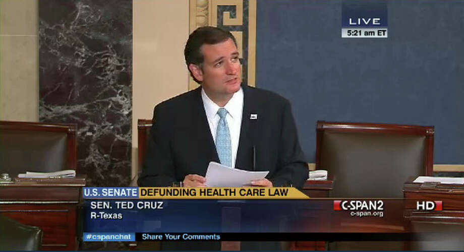 In an image made from the C-Span broadcast Senator Ted Cruz continues to speak on the floor of the U.S. Senate at 5:21 a.m. EDT Wednesday Sept. 25, 2013. Since Tuesday afternoon, Cruz _ with occasional remarks by Sen. Mike Lee, R-Utah, and other GOP conservatives _ have controlled the Senate floor and railed against Obamacare. By 5 a.m. EDT Wednesday, Cruz and his allies had spoken for more than 14 hours, the eighth longest since precise record-keeping began in 1900. (AP Photo/CSPAN) / CSPAN