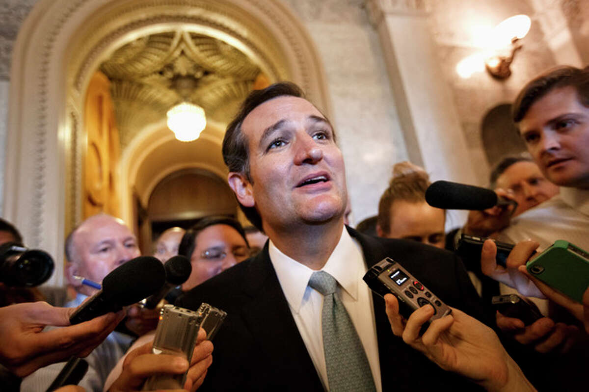AP Photo/J. Scott Applewhite Sen. Ted Cruz, R-Texas talks to reporters as he emerges from the Senate Chamber on Capitol Hill in Washington, Wednesday, after his overnight crusade railing against the Affordable Care Act.