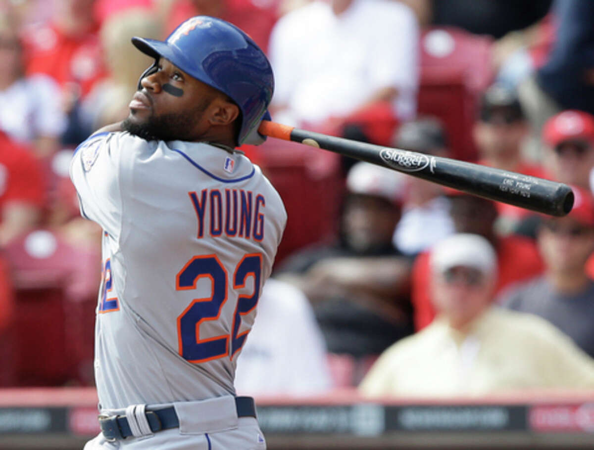 New York Mets' Eric Young Jr. hits a single off Cincinnati Reds starting pitcher Mat Latos to drive in a run in the third inning of a baseball game, Wednesday, Sept. 25, 2013, in Cincinnati. (AP Photo/Al Behrman)