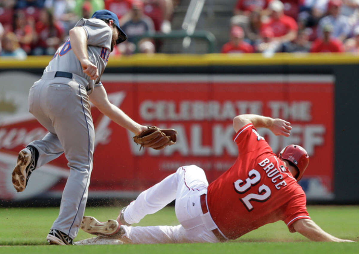 Cincinnati Reds' Jay Bruce (32) steals second base as New York Mets second baseman Daniel Murphy (28) is late with the tag in the fourth inning of a baseball game, Wednesday, Sept. 25, 2013, in Cincinnati. (AP Photo/Al Behrman)