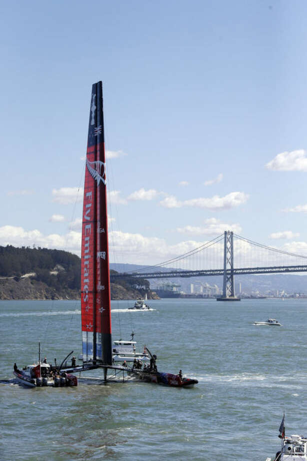 Emirates Team New Zealand heads to the start before the19th race of the America's Cup sailing event against Oracle Team USA on Wednesday, Sept. 25, 2013, in San Francisco. (AP Photo/Marcio Jose Sanchez)