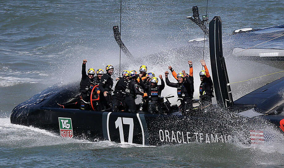 The crew on Oracle Team USA celebrates after winning the 19th race against Emirates Team New Zealand to win the America's Cup sailing event, Wednesday, Sept. 25, 2013, in San Francisco. (AP Photo/Marcio Jose Sanchez) / AP