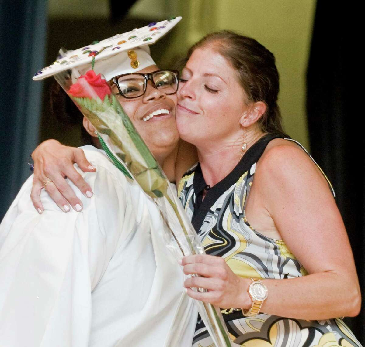 Stamford Academy graduate Keyondra Gay gets a hug from Director of Curriculum Andrea Weller during the graduation ceremony held at Trailblazers Academy in Stamford. Wednesday, June 15, 2016