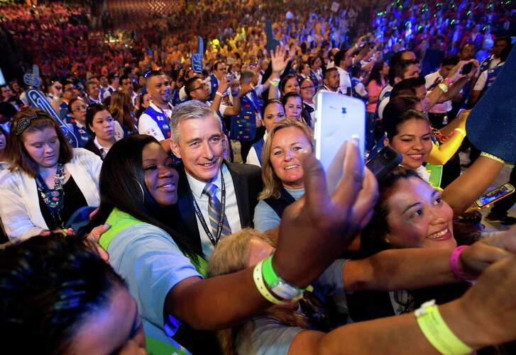 Greg Foran (center), chief executive officer and president, takes photos with associates before the annual Wal-Mart Shareholders Meeting on Friday, June 3, 2016,  in Fayetteville, Ark.  (Jason Ivester/The Arkansas Democrat-Gazette via AP)  MANDATORY CREDIT