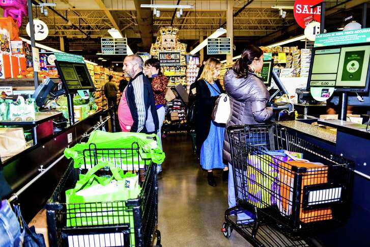 FILE -- Shoppers at a Whole Foods in New York, Oct. 30, 2015. The Food and Drug Administration in June of 2016 sent a stern warning letter to Whole Foods Market, saying the upscale grocer had failed to address a long list of food safety issues the agency raised after an inspection at a plant in Massachusetts that makes prepared foods for its stores in the Northeast. (Dolly Faibyshev/The New York Times)
