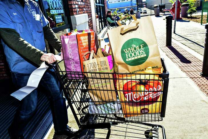 """A shopping cart is full of items at a Whole Foods in New York. The Austin-based company says it had taken steps to correct problems that the FDA has found. """"WThe Food and Drug Administration in June of 2016 sent a stern warning letter to Whole Foods Market, saying the upscale grocer had failed to address a long list of food safety issues the agency raised after an inspection at a plant in Massachusetts that makes prepared foods for its stores in the Northeast. (Dolly Faibyshev/The New York Times) FILE -- A shopping cart full of food at a Whole Foods in New York, Oct. 30, 2015. The Food and Drug Administration in June of 2016 sent a stern warning letter to Whole Foods Market, saying the upscale grocer had failed to address a long list of food safety issues the agency raised after an inspection at a plant in Massachusetts that makes prepared foods for its stores in the Northeast. (Dolly Faibyshev/The New York Times)"""