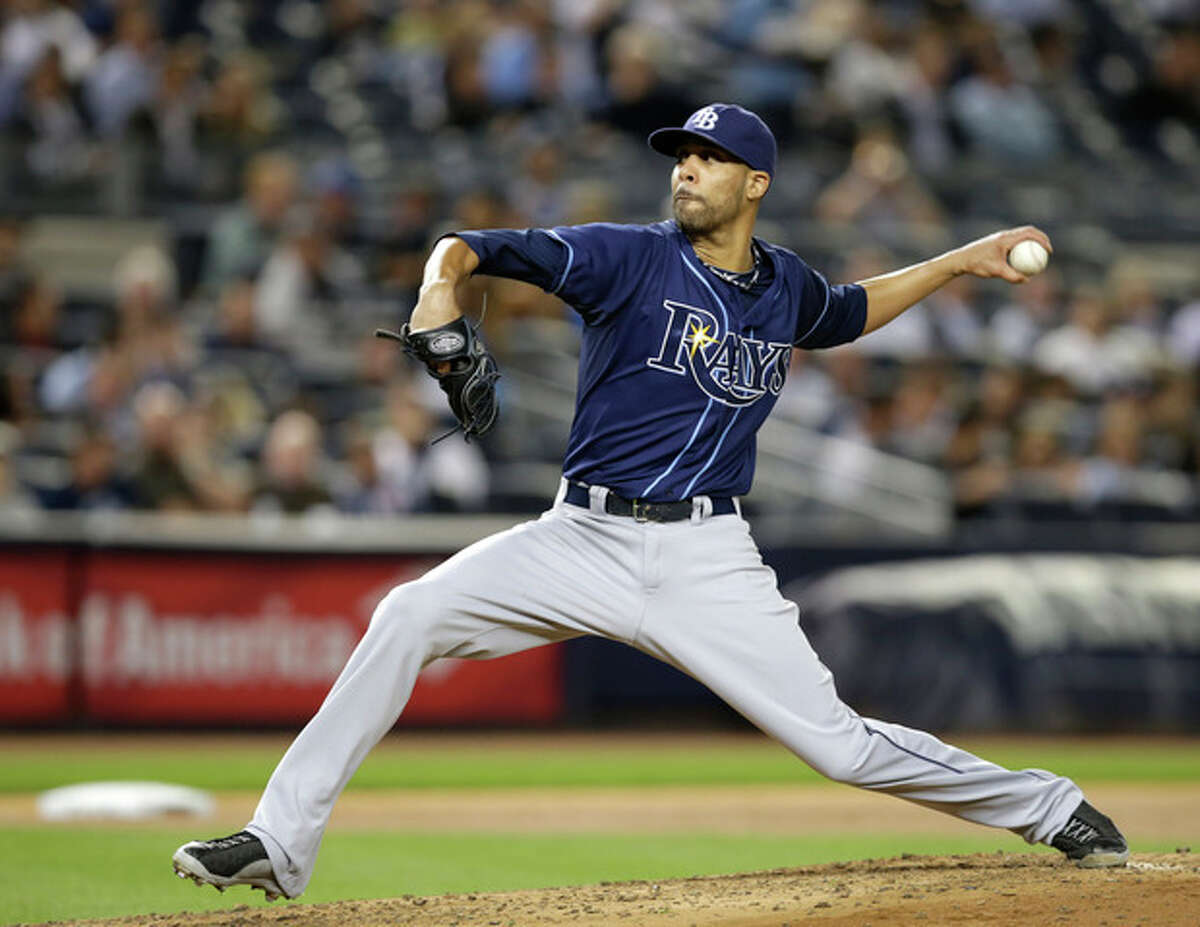 Tampa Bay Rays starting pitcher David Price delivers to a New York Yankees batter in the second inning of a baseball game, Wednesday, Sept. 25, 2013, in New York. (AP Photo/Kathy Willens)