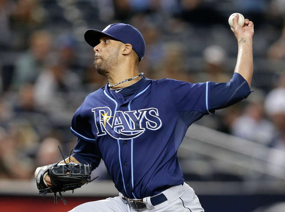 Tampa Bay Rays starting pitcher David Price delivers against the New York Yankees in the third inning of a baseball game, Wednesday, Sept. 25, 2013, in New York. (AP Photo/Kathy Willens) / AP