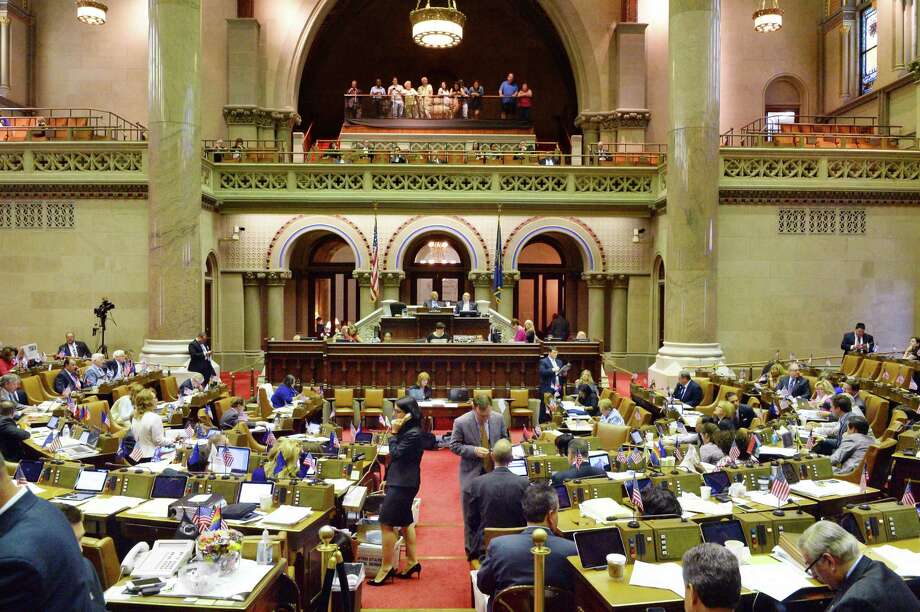 The Assembly Chamber buzzes with activity as voting on bills continues Wednesday June 15, 2016 in Albany, NY.   (John Carl D'Annibale / Times Union) Photo: John Carl D'Annibale