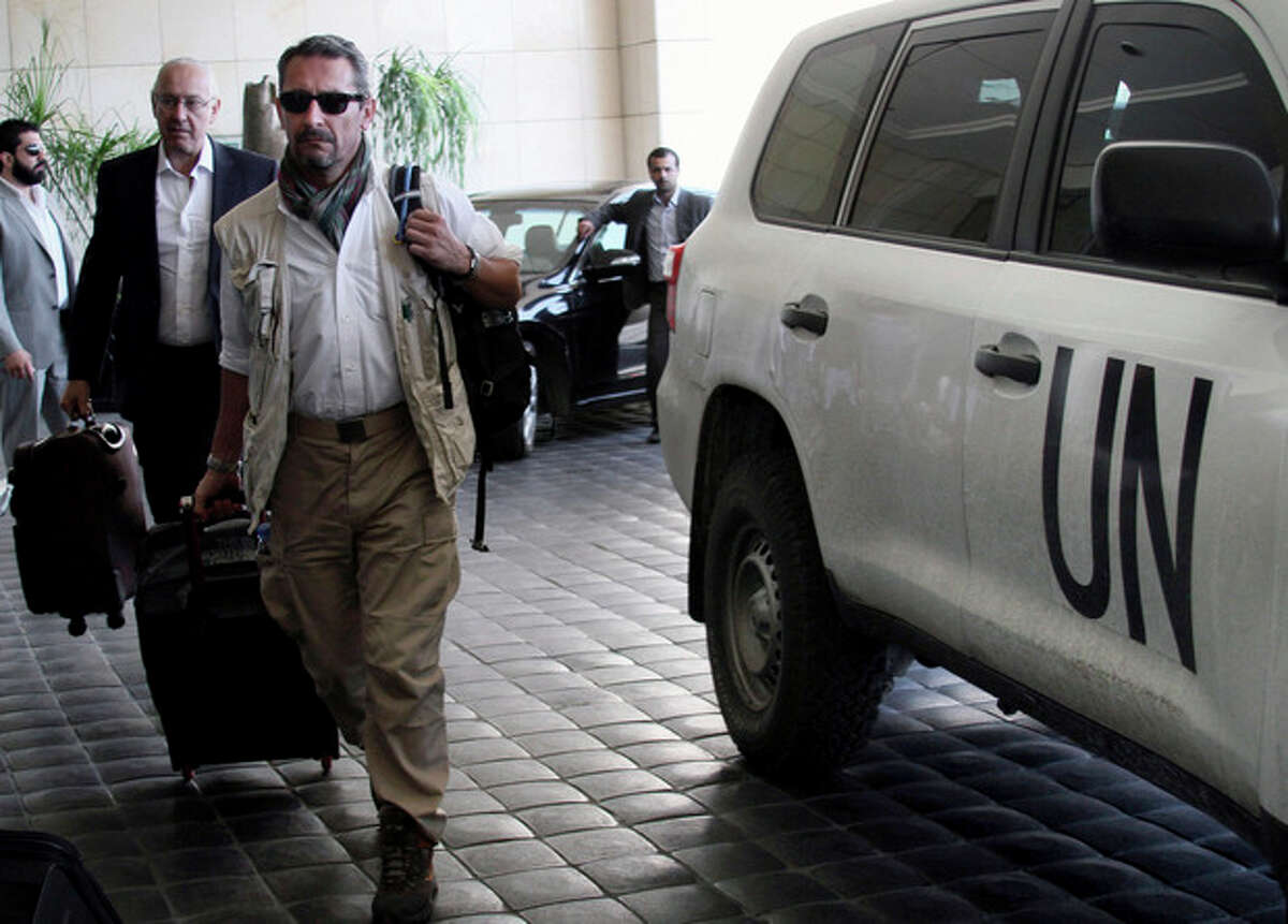 U.N. experts arrive to the Four Seasons hotel in Damascus, Syria, Wednesday, Sept. 25, 2013. A team of U.N. chemical weapons inspectors returned to Damascus on Wednesday to complete their investigation into what the UN calls