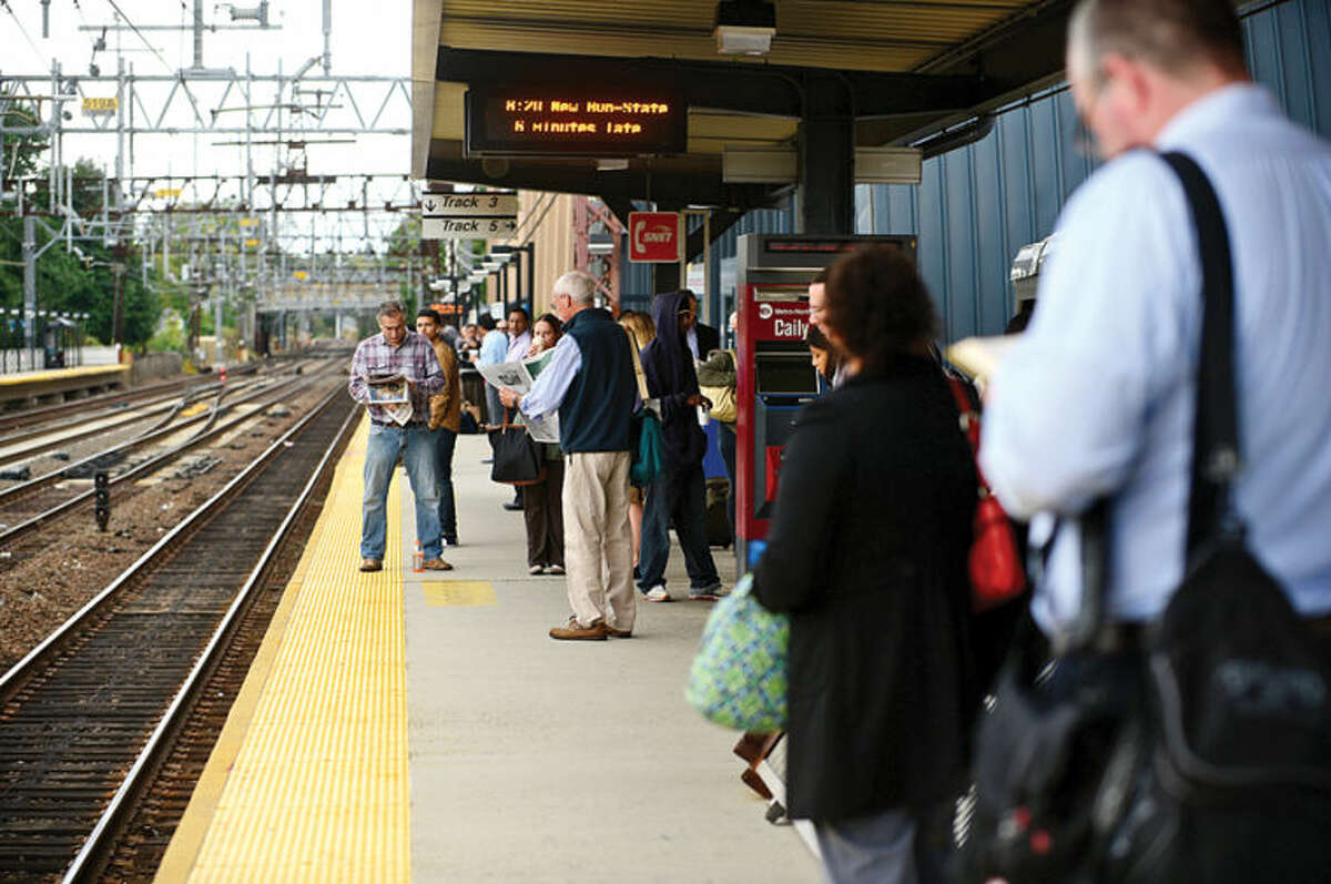 Hour photo / Erik Trautmann Metro North passengers get to their destinations Thursday morning at the South Norwalk train station.