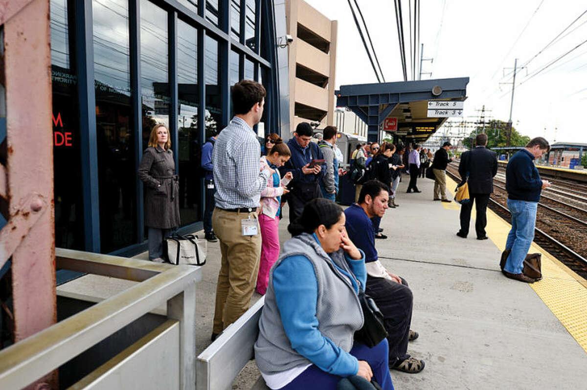 Hour photo / Erik Trautmann Metro North passengers get to their destinations Thursday morning at the South Norwalk train station.