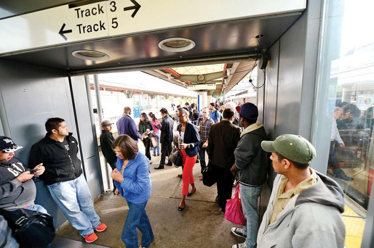 Hour photo / Erik Trautmann Metro North passengers get to their destinations Thursday morning at the Stamford train station.