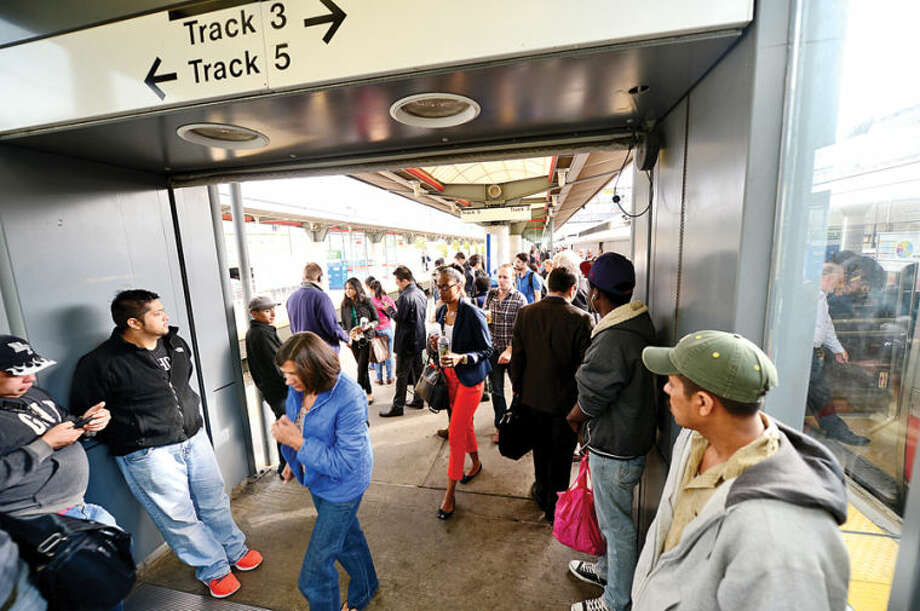 Hour photo / Erik Trautmann Metro North passengers get to their destinations Thursday morning at the Stamford train station.