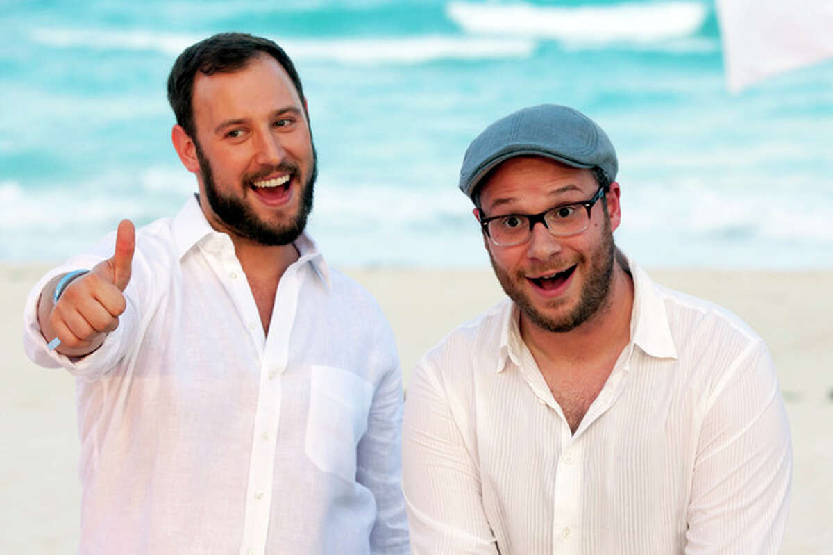 FILE - This April 21, 2013 file photo shows Evan Goldberg, left, and Seth Rogen, posing on a beach as they promote their film