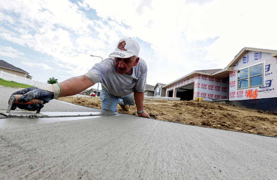 FILE - In this Thursday, Aug. 1, 2013, file photo, a sidewalk gets shaped in front of new construction in Omaha, Neb._The Commerce Department reports on new-home sales for August on Wednesday, Sept. 25, 2013. (AP Photo/Nati Harnik) / AP