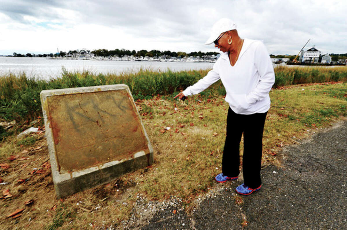 Hour photo / Erik Trautmann Frequent visitor to Veteran's Memorial Park, BJ Depina, discovered the letters, k-k-k, spray painted on a concrete monument at in Norwalk recently.
