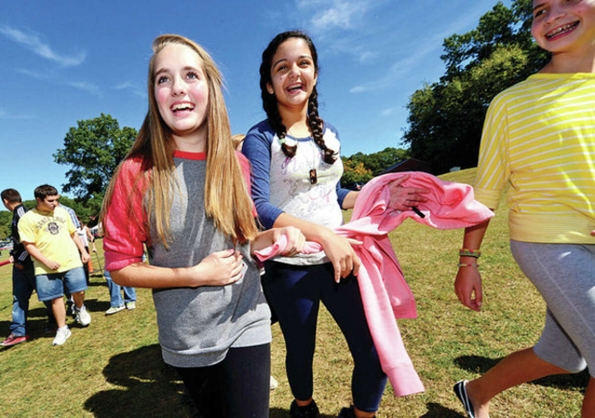 Hour photo / Erik Trautmann Ponus Ridge Middle School students Katie DiJoseph who raised $1200 and Cathy Colmenares walk to help raise money for the school's PTO and awareness about living a healthy lifestyle Wednesday.