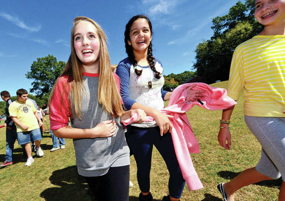 Hour photo / Erik Trautmann Ponus Ridge Middle School students Katie DiJoseph who raised $1200 and Cathy Colmenares walk to help raise money for the school's PTO and awareness about living a healthy lifestyle Wednesday. / (C)2013, The Hour Newspapers, all rights reserved