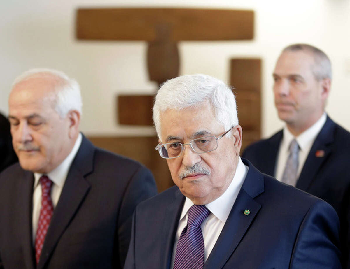 Palestinian President Mahmoud Abbas, center, arrives during the 68th session of the General Assembly at United Nations headquarters, Thursday, Sept. 26, 2013. (AP Photo/Seth Wenig)