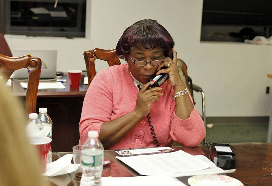 Corinne Weston works the telephone at the grand opening of Democratic Mayoral Candidate Harry W. Rilling's new campaign headquarters on VanZant Street in Norwalk Wednesday evening. Hour Photo / Danielle Calloway