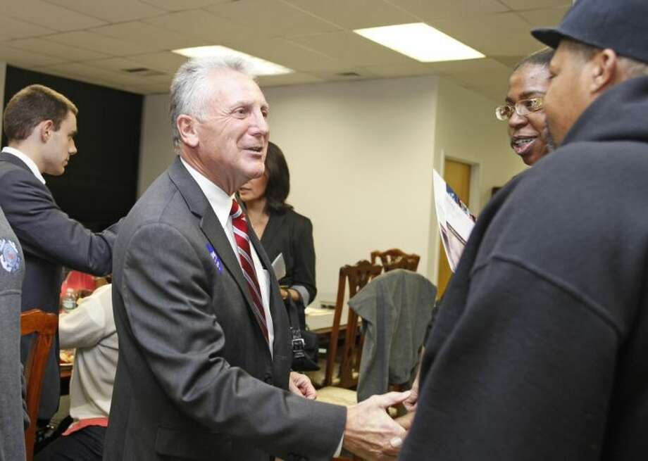 Democratic Mayoral Candidate Harry W. Rilling greets guests at the grand opening of his new campaign headquarters on Van Zant Street in Norwalk Wednesday evening. Hour Photo / Danielle Calloway