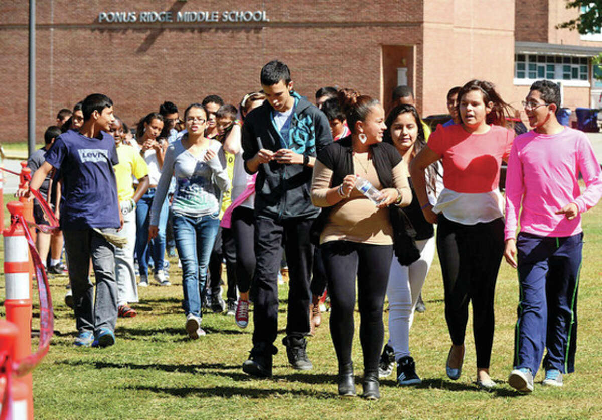 Hour photo / Erik Trautmann Ponus Ridge Middle School students walk to help raise money for the school's PTO and awareness about living a healthy lifestyle Wednesday.